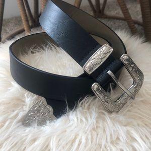 Black Western belt with silver buckle